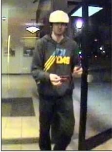Bombing suspect Dzhokhar Tsarnaev appeared in a photo taken by a camera at a Bank of America ATM in Watertown before he and his brother engaged in a gun battle with police.
